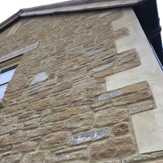 Lime mortar pointing. Softer and more porous than cement alternatives allowing moisture to evaporate.